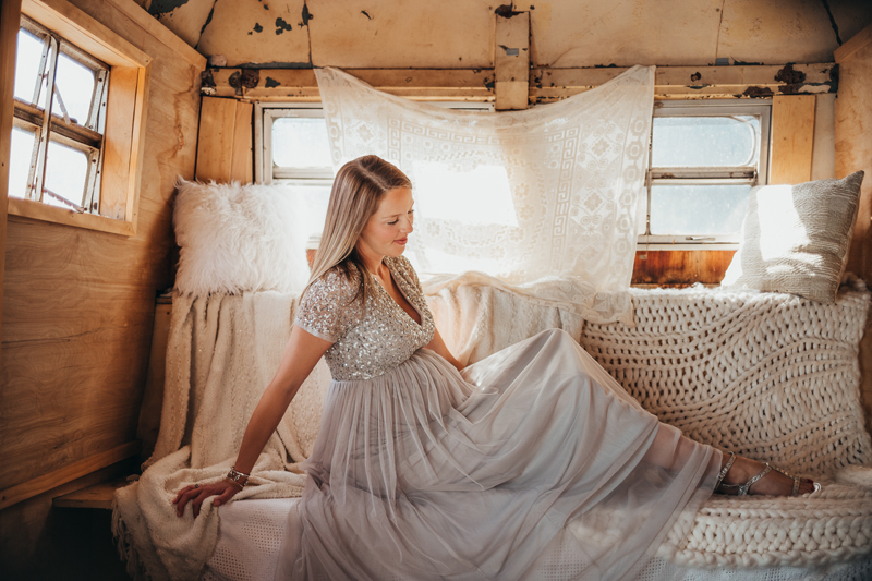 Temecula Maternity Photographer, mother sitting on a bench seat in old VW bus