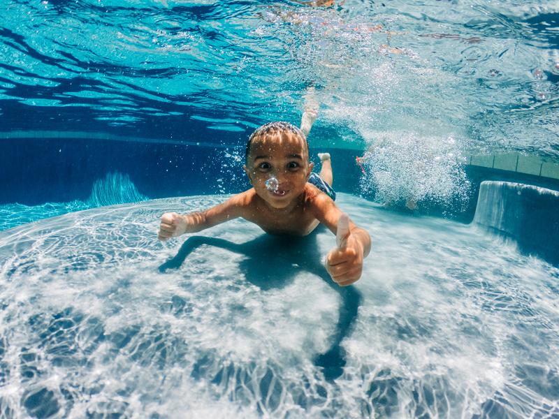 Temecula Lifestyle Documentary Photographer, little boy swimming underwater