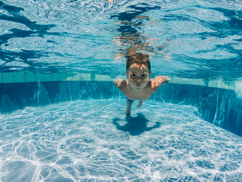 Temecula Lifestyle Documentary Photographer, little boy swimming in pool