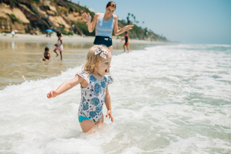 Temecula Lifestyle Documentary Photographer, little girl playing in the water at beach