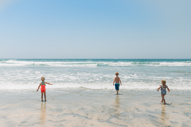 Temecula Lifestyle Documentary Photographer, three little kids playing at the beach