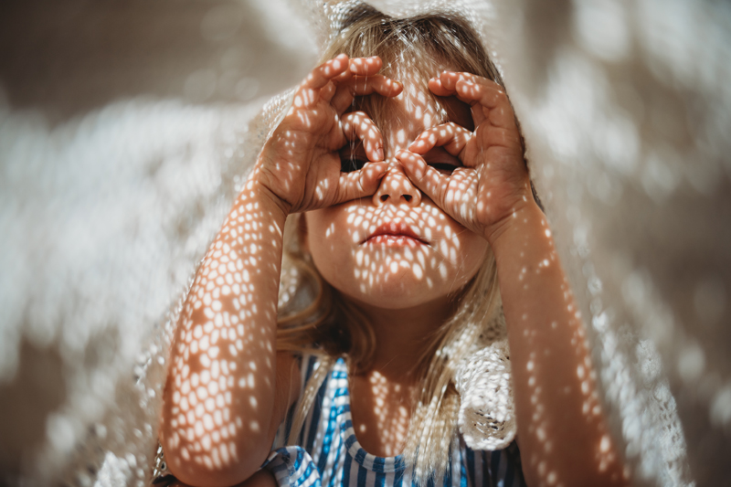 Temecula Lifestyle Documentary Photographer, little girl playing under a blanket