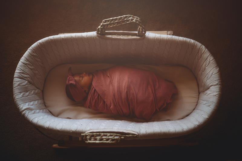 Temecula Newborn Photographer, baby asleep in Moses basket
