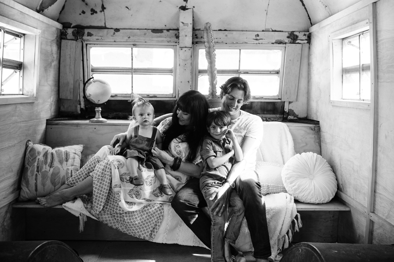 Temecula Family Photographer, black and white image of family sitting in the back of a bus