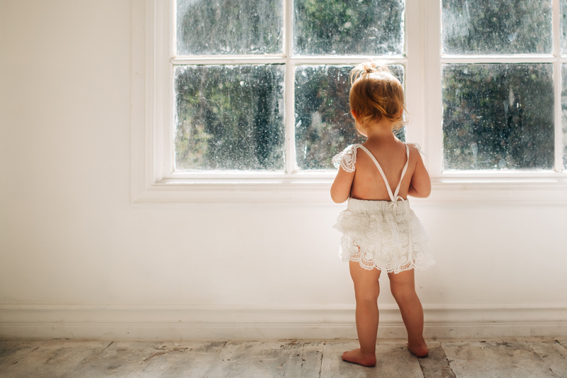Temecula Family Photographer, little girl standing next to window