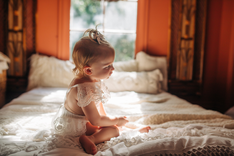 Temecula Family Photographer, little girl sitting on bed