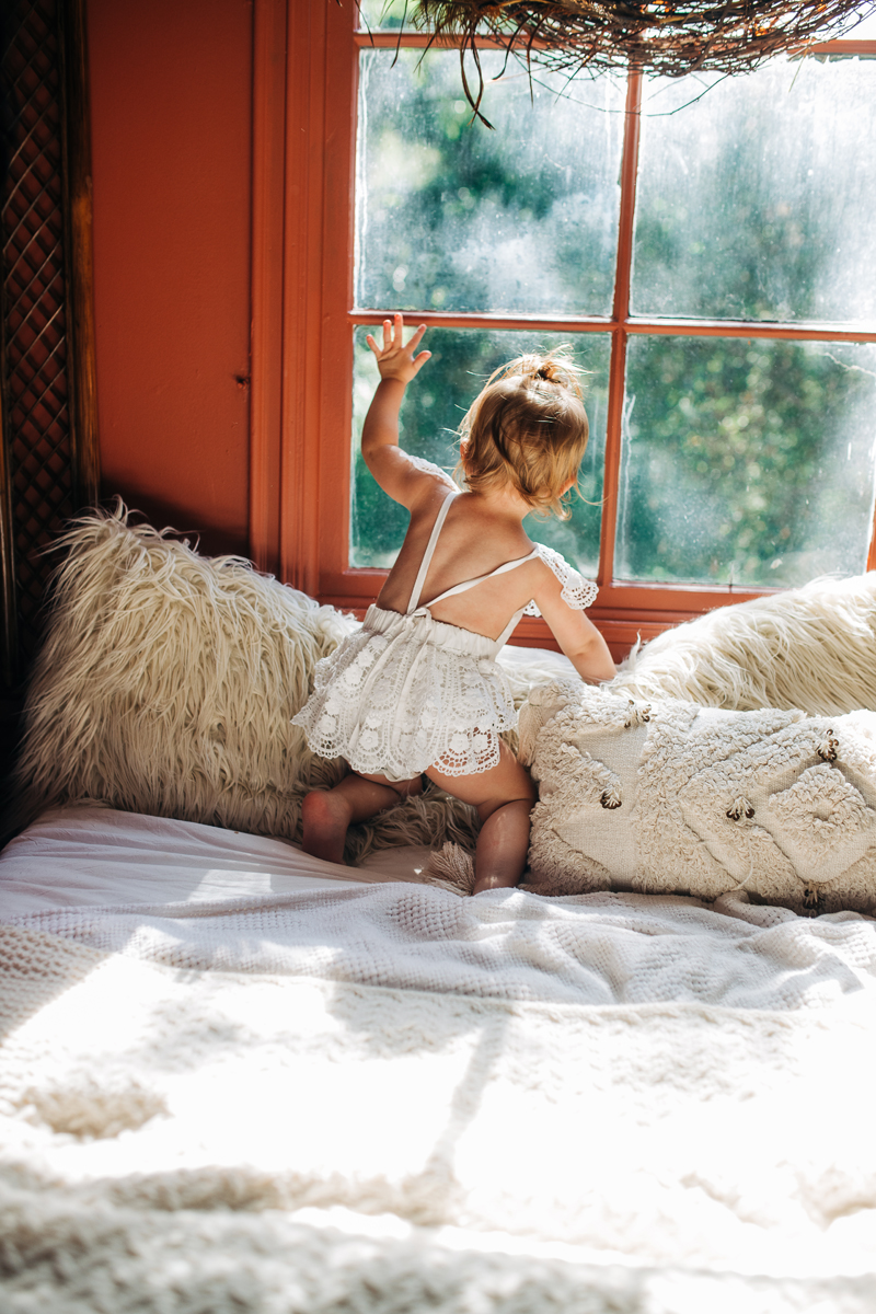 Temecula Family Photographer, little girl looking out the window