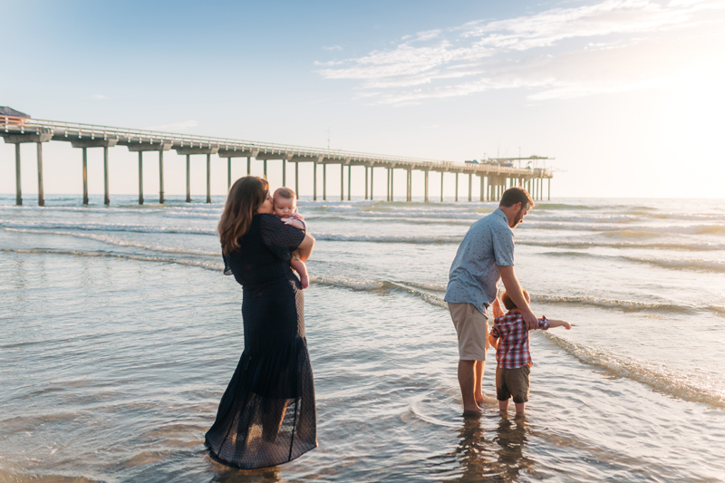 Temecula Family Photographer, family of 4 playing at the beach