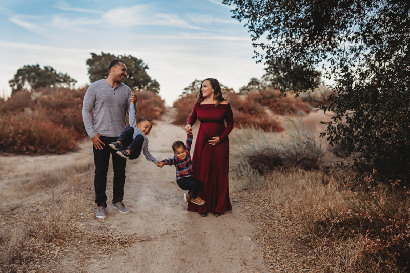 Temecula Family Photographer, family of 4 walking down a dirt path
