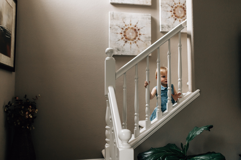 Temecula Lifestyle Documentary Photographer, little girl sitting on a staircase