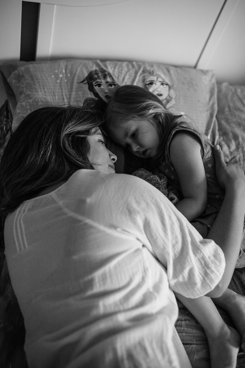 Temecula Lifestyle Documentary Photographer, mother laying in bed with daughter