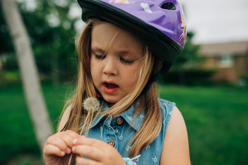 Temecula Lifestyle Documentary Photographer, little girl blowing on a dandelion