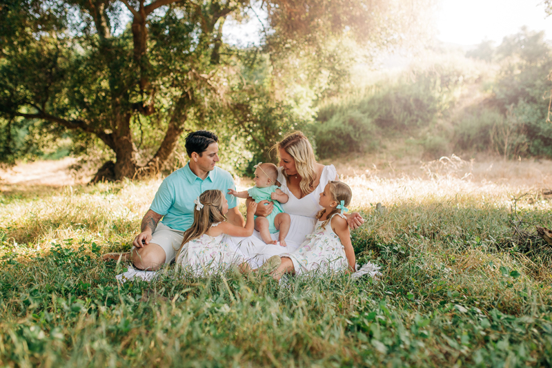 Temecula Family Photographer, family of 5 sitting in the grass together