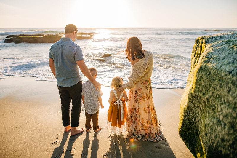 Temecula Family Photographer, family on the beach looking at water