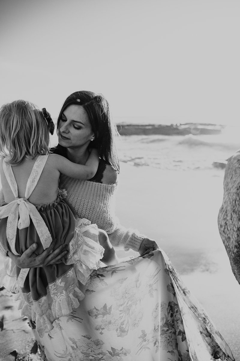 Temecula Family Photographer, black and white of mom and daughter on the beach